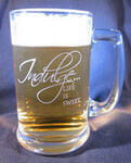 Customized beer mug with engraved 'Indulge' design deeply sandblasted by hand out of the glass for a personalized custom beer mug