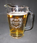 Engraved pitcher with etched custom text deeply sandblasted by hand out of the glass for a personalized custom beer pitcher