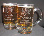 Personalized beer mug with engraved custom design and text deeply sandblasted by hand out of the glass for a personalized custom beer mug