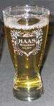 Personalized pilsner with etched custom text deeply sandblasted by hand out of the glass for a personalized custom beer pilsner