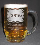 Customized beer stein with etched custom text and desing deeply sandblasted by hand out of the glass for a personalized custom beer mug