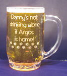 Personalized beer mug with etched custom text deeply sandblasted by hand out of the glass for a personalized custom beer mug
